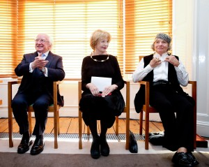 15/09/2015 NO REPRO FEE, MAXWELLS DUBLIN PIC SHOWS: The President of Ireland, Michael D. Higgins are pictured at the Arts Council offices today (tues) with l to r writer Edna O'Brien and visual artist Imogen Stuart. The President of Ireland, Michael D. Higgins, presided at a ceremony this afternoon, Tuesday 15th September 2015, to mark the election of visual artist Imogen Stuart and writers Edna O'Brien and William Trevor as Saoithe in Aosdána. The honour of Saoi is bestowed for singular and sustained distinction in the creative arts; this afternoon, the President presented both Imogen and Edna with the symbol of the office, a gold torc. A representative of William Trevor accepted the torc on his behalf. The ceremony took place at 2:30pm at the Arts Council's offices at 70 Merrion Square, Dublin 2. Aosdána was established in 1981 by the Arts Council to acknowledge creative artists who have made an outstanding contribution to the arts in Ireland.  Membership of Aosdána, which is by peer nomination and election, is open to artists engaged in architecture, choreography, music, literature and the visual arts and, currently, the body has 249 members. Members must have been born in Ireland or have been resident here for five years, and must have produced a body of original work. Members of Aosdána nominate and elect the Saoithe and no more than seven artists may hold this honour at any one time.  The present Saoithe are: Seoirse Bodley (music), Anthony Cronin (literature), Brian Friel (literature), Edna O'Brien (literature), Camille Souter (visual arts), Imogen Stuart (visual arts),William Trevor (literature). The ceremony was attended by many of the artists' colleagues and numerous members of Aosdána, including Mary FitzGerald, Theo Dorgan and Vivienne Dick. Also present were Arts Council Director, Orlaith McBride; Arts Council Chair, Sheila Pratschke; and Registrar of Aosdána, Audrey Keane. PIC: NO FEE, MAXWELLS  Joe Stuart | Head of Press and Communicatio